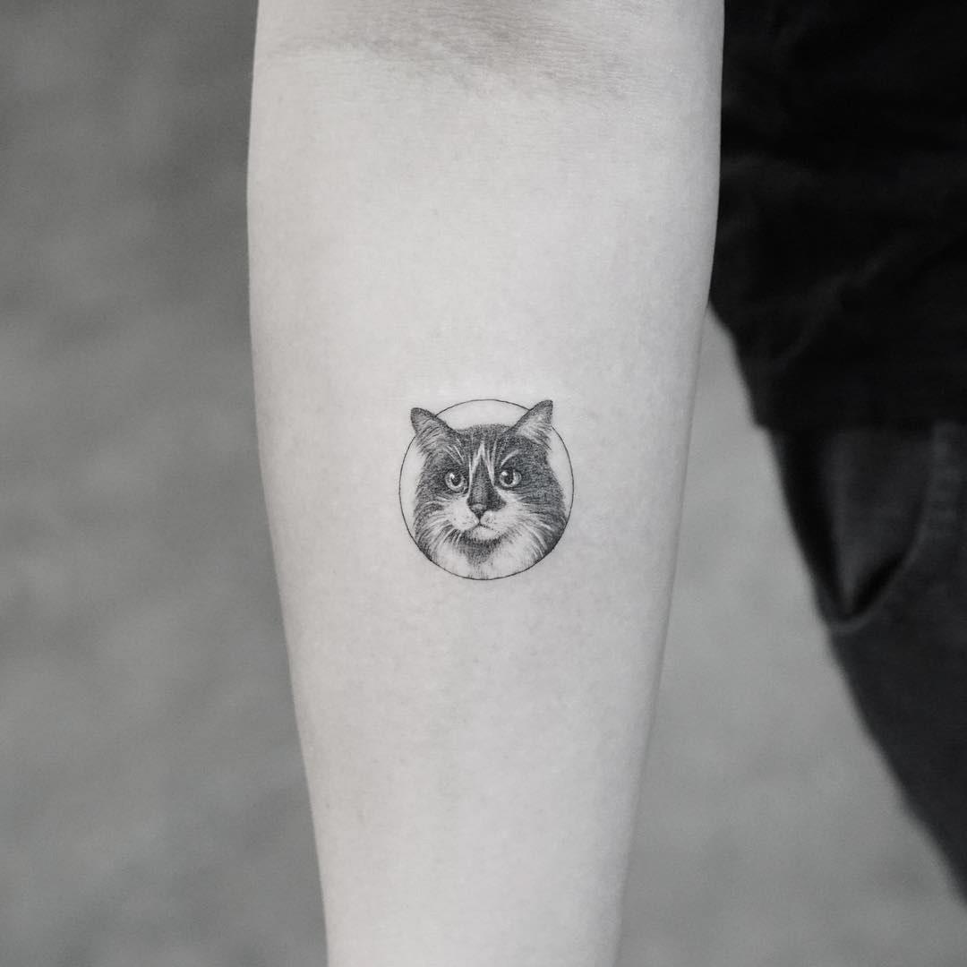 cat face tattoo small