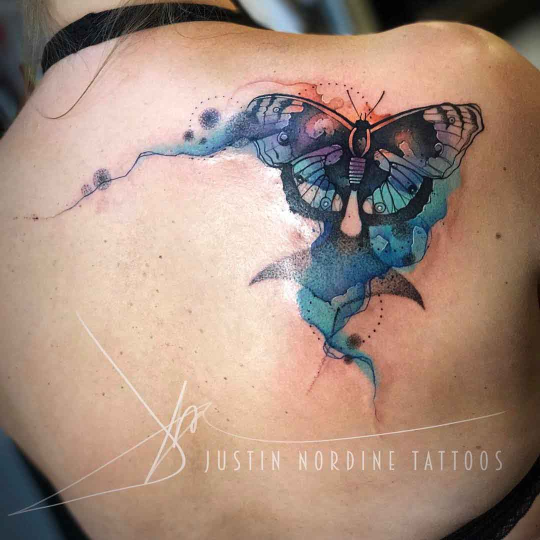 butterfly tattoo on shoulder blade watercolor style