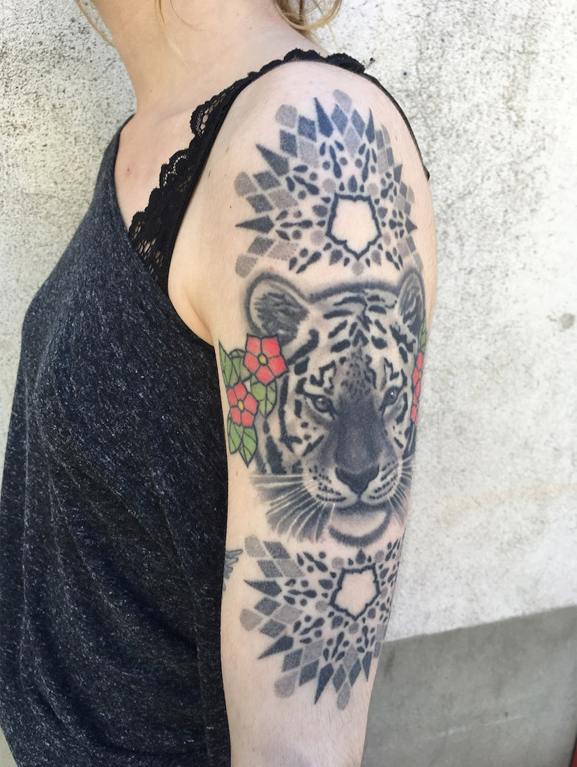 mandala and tiger tattoo on shoulder