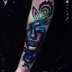 Blue Abstract Portrait Tattoo