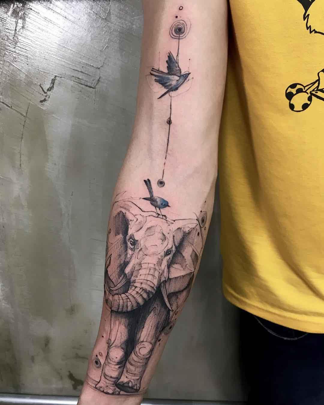 arm tattoo elephant and birds