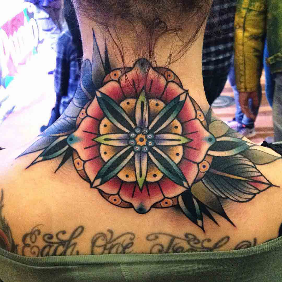 traditional flower tattoo on back of the neck