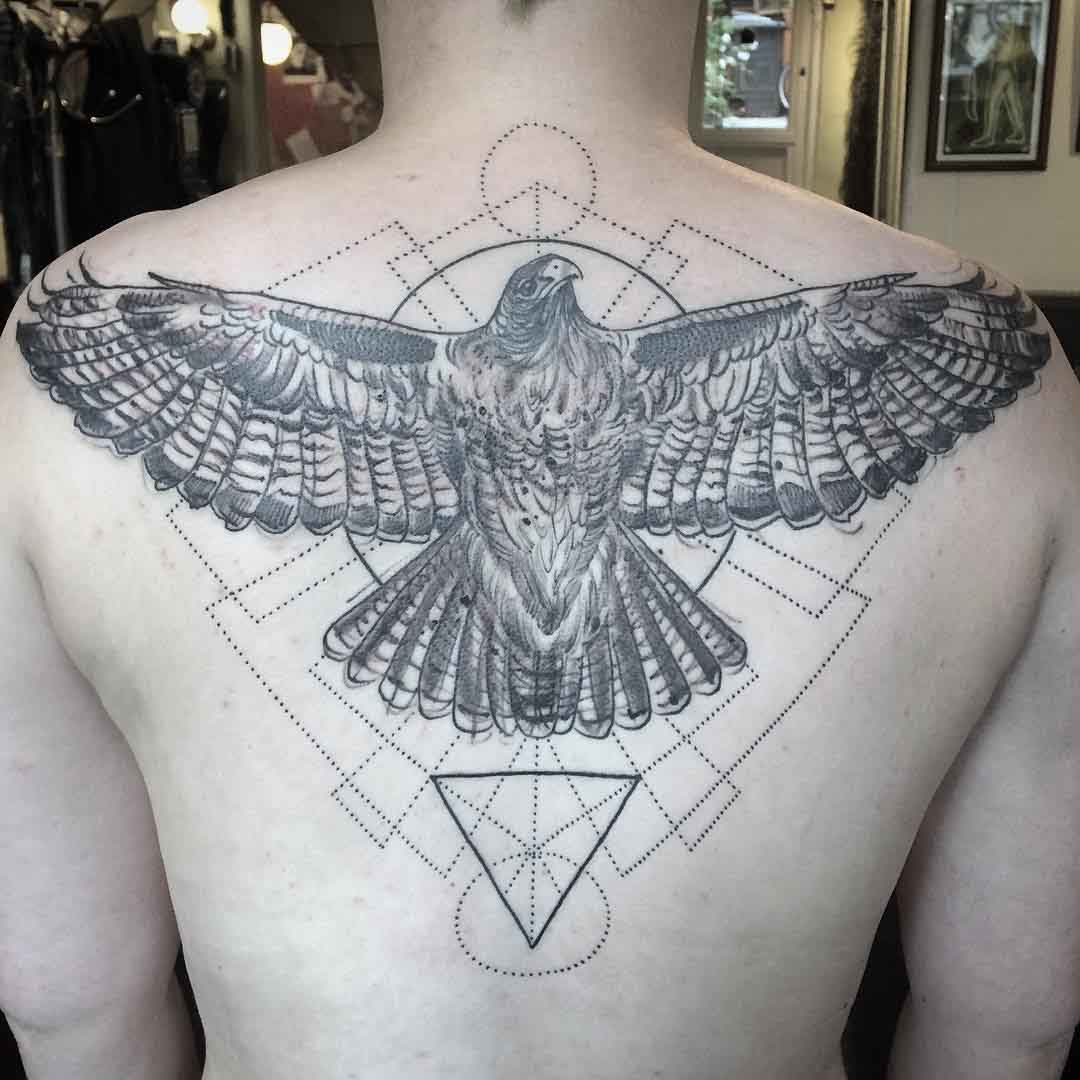 geometric eagle tattoo on back