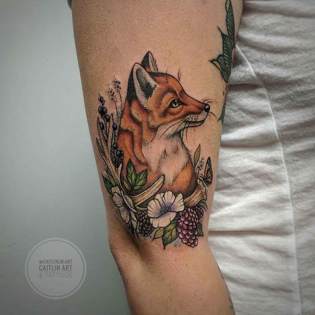 arm tattoo of fox in berries