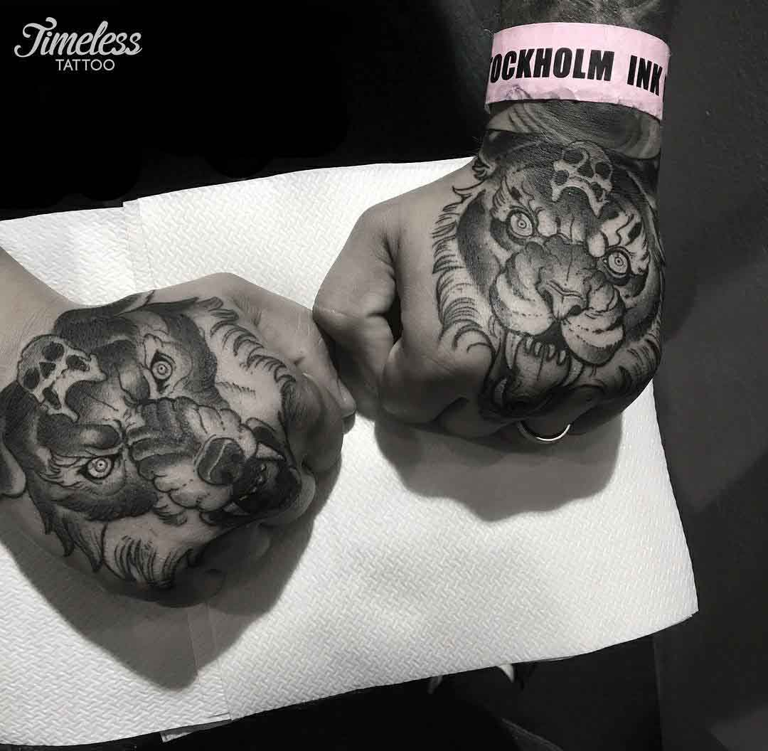 wolf and tiger hand tattoos