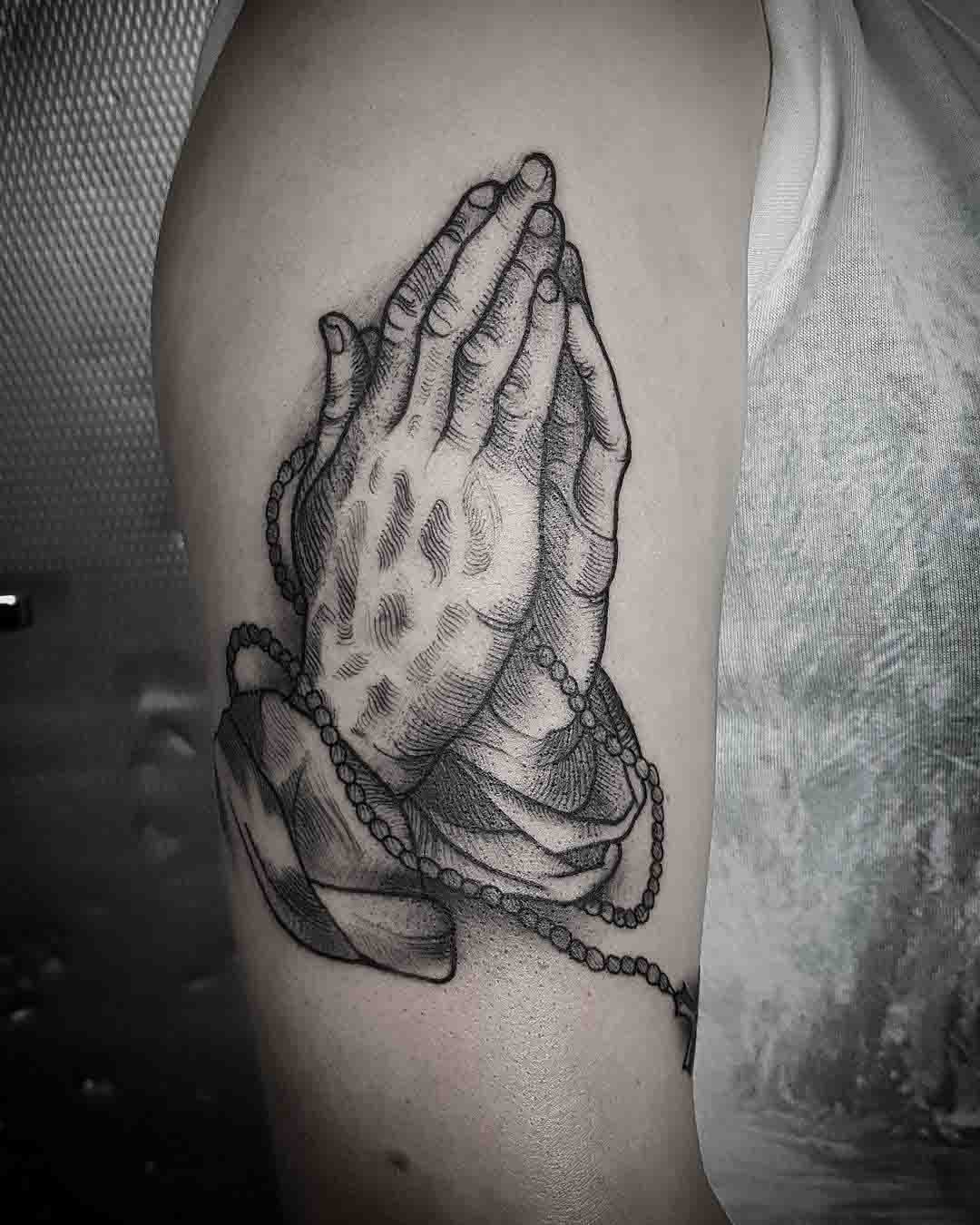 parying hands tattoo