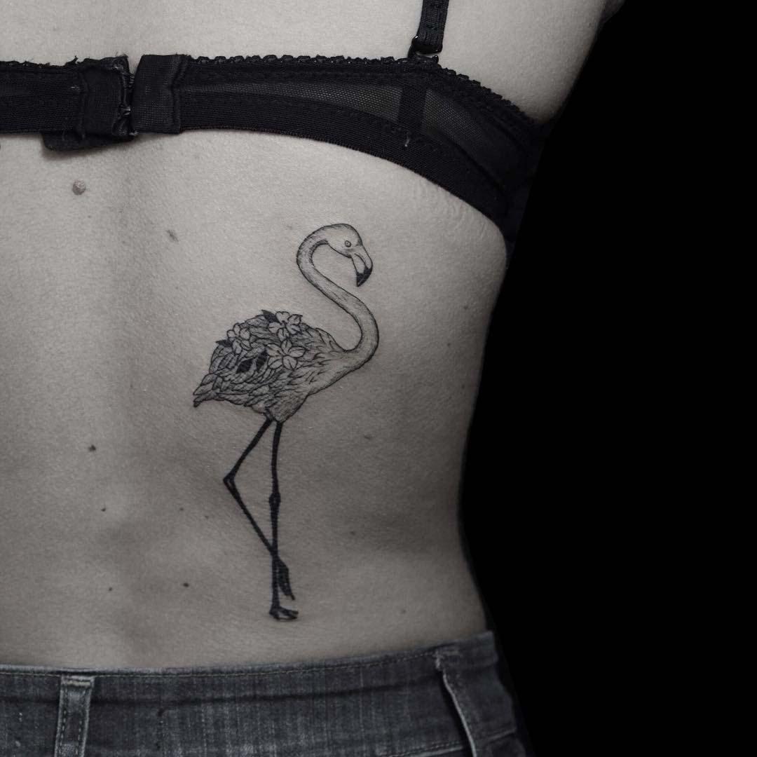 floral flamingo tattoo on back side