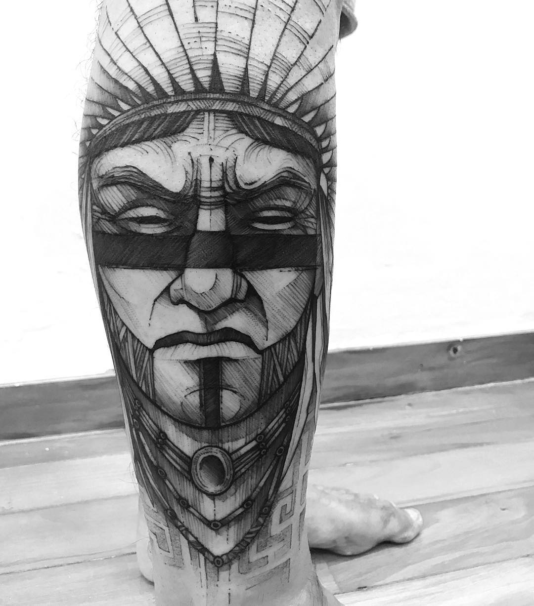 angry indian tattoo on leg