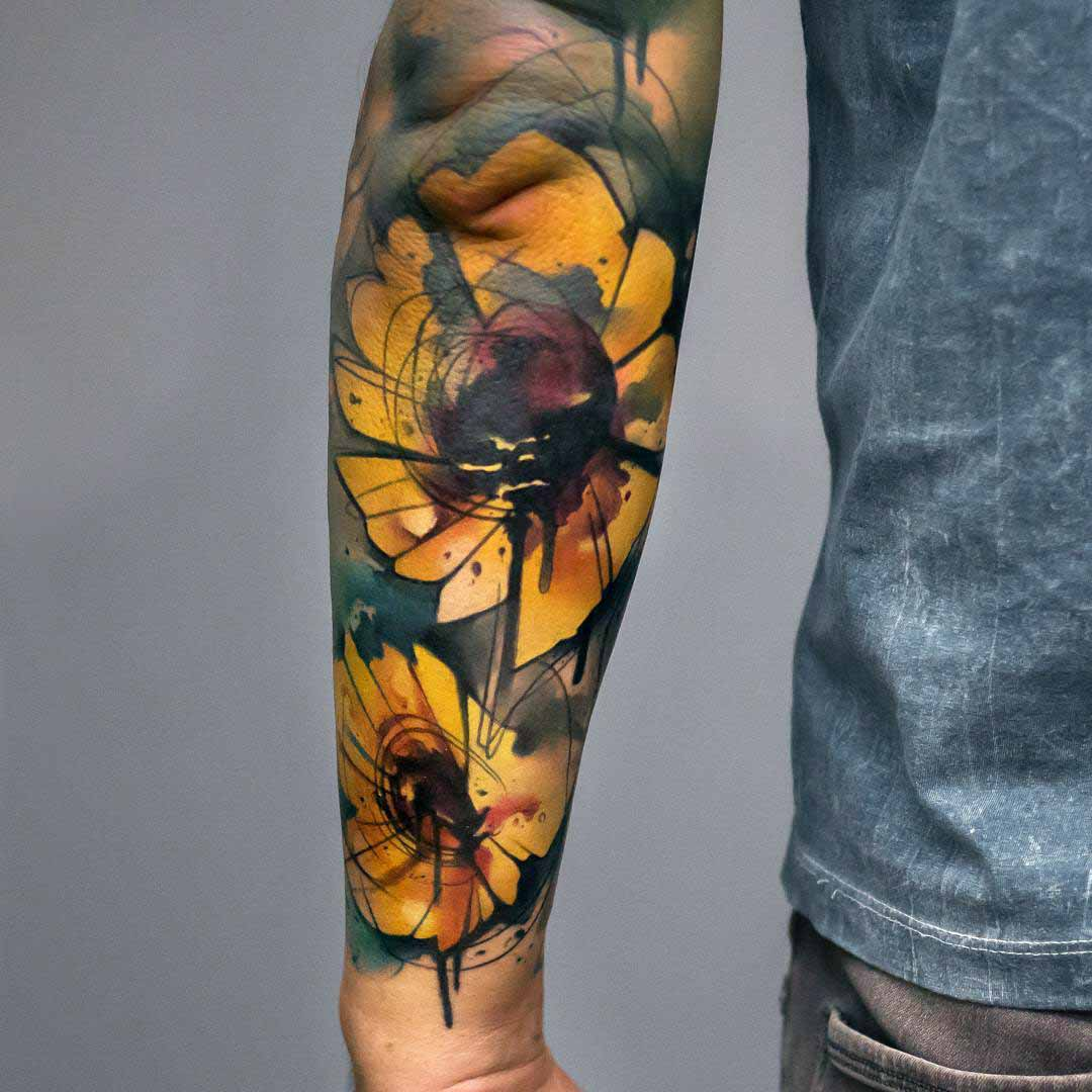 forearm sunflowers tattoo watercolor style