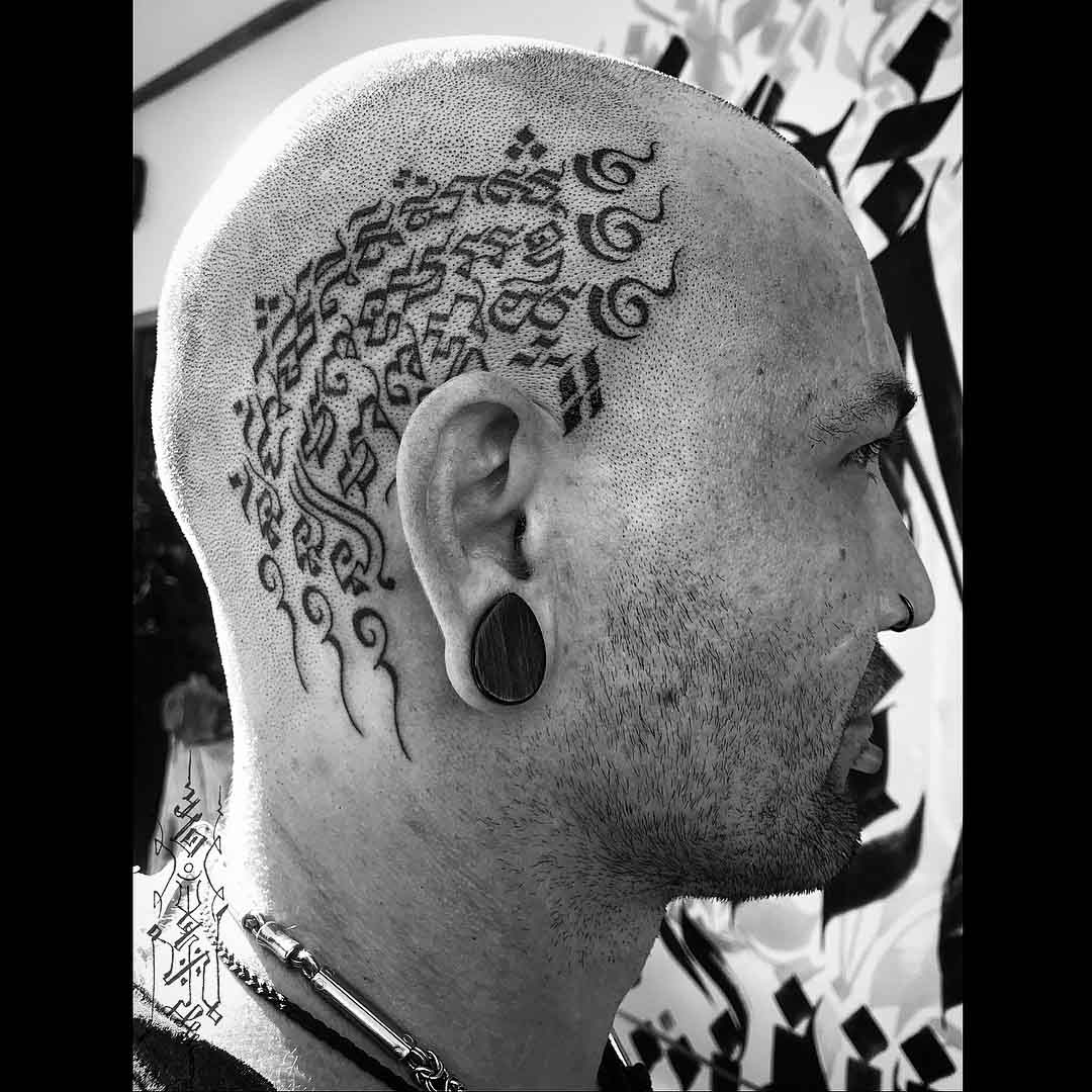 head tattoo on side