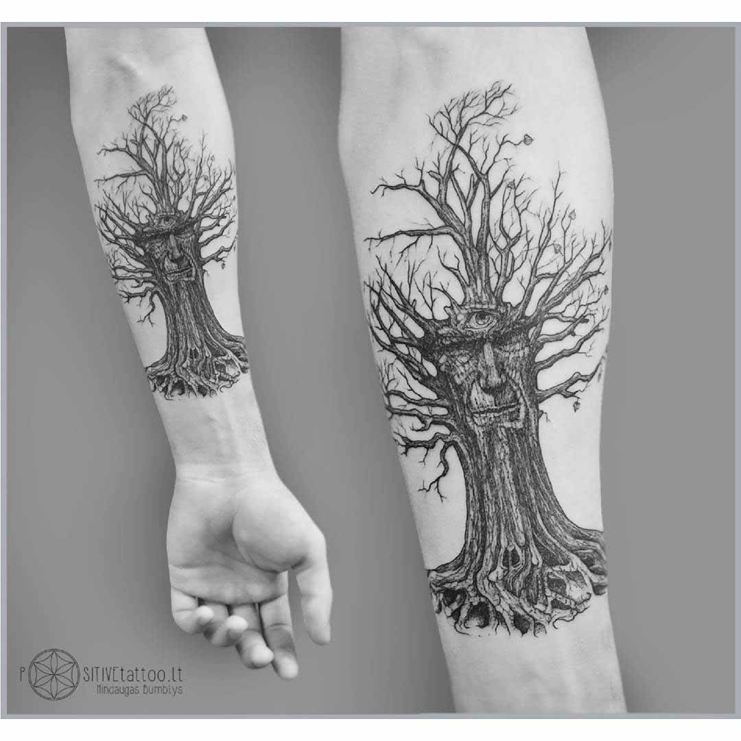 arm tattoo wise old tree