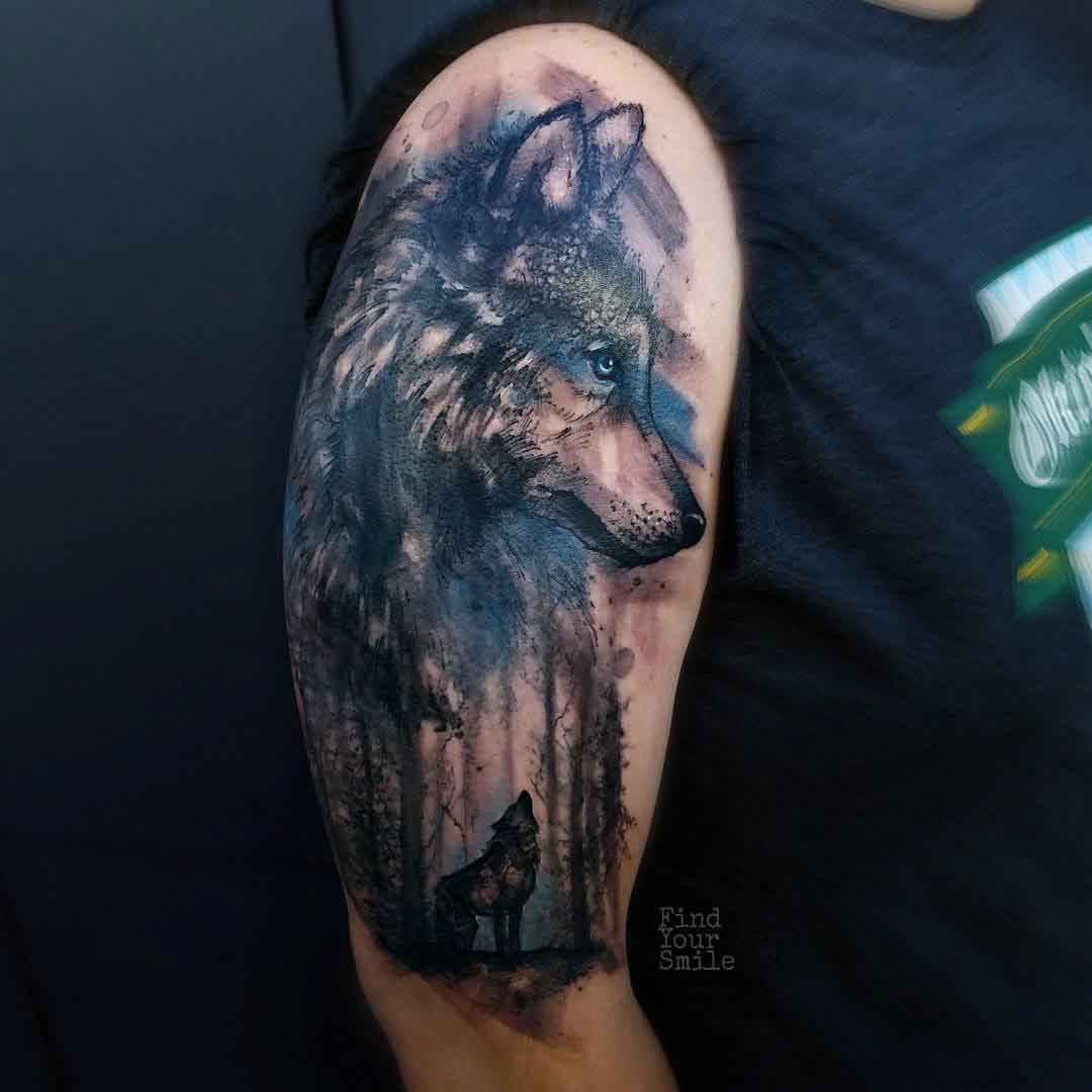 watercolor wolf tattoo on shoulder