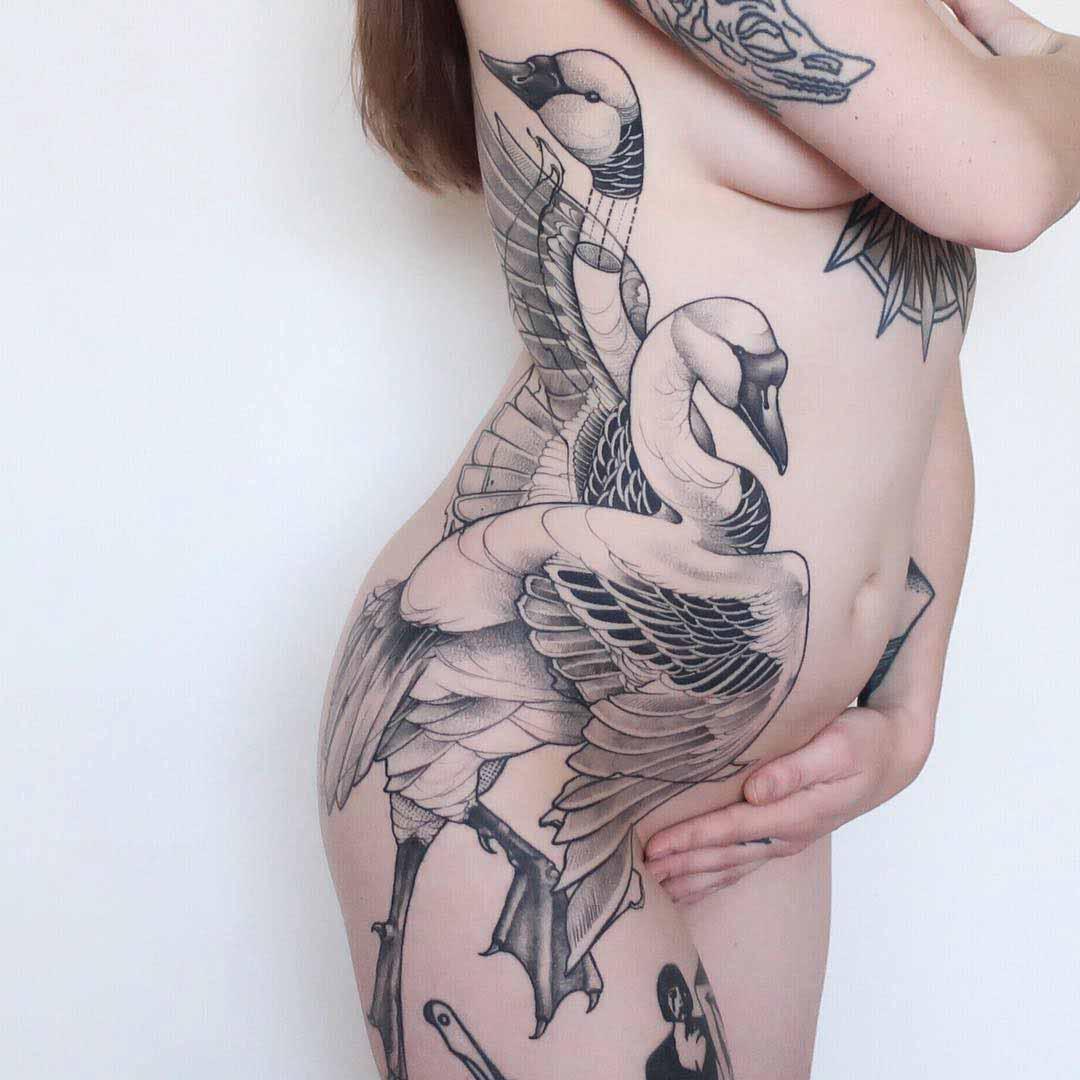 body side tattoo swans