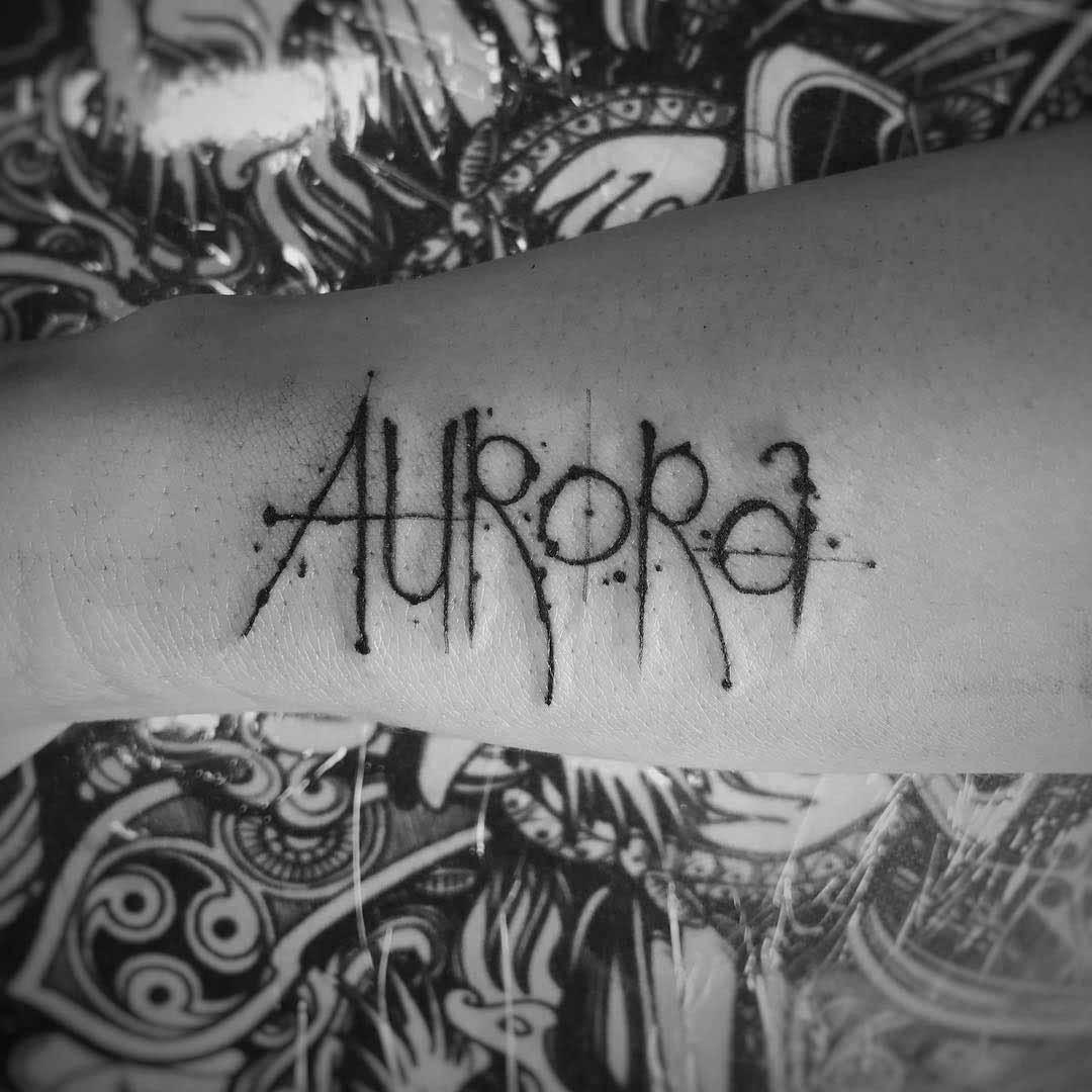 arm tattoo aurora lettering