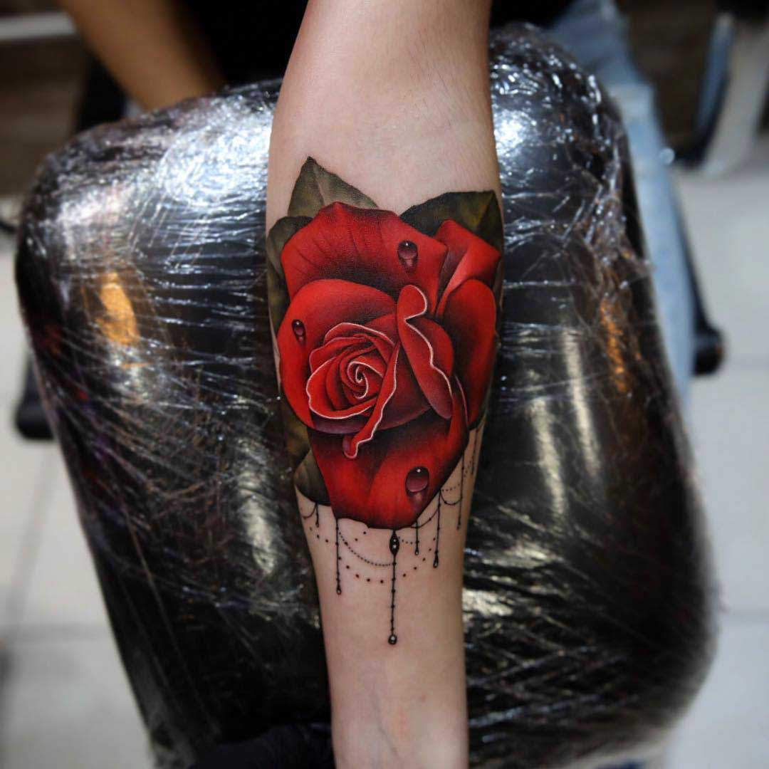 arm tattoo red rose