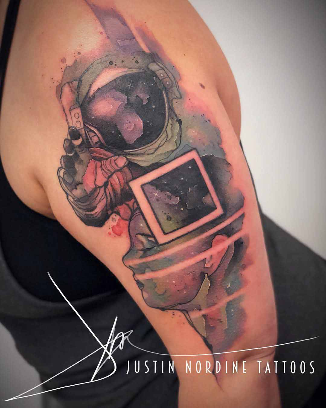watercolor tattoo astronaut on shoulder