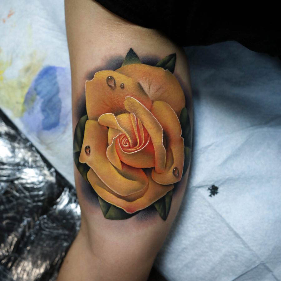 bicep tattoo ellow rose