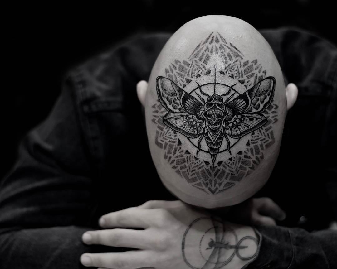 head tattoo moth