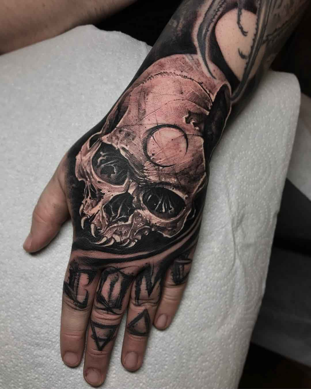 moon skull tattoo on hand