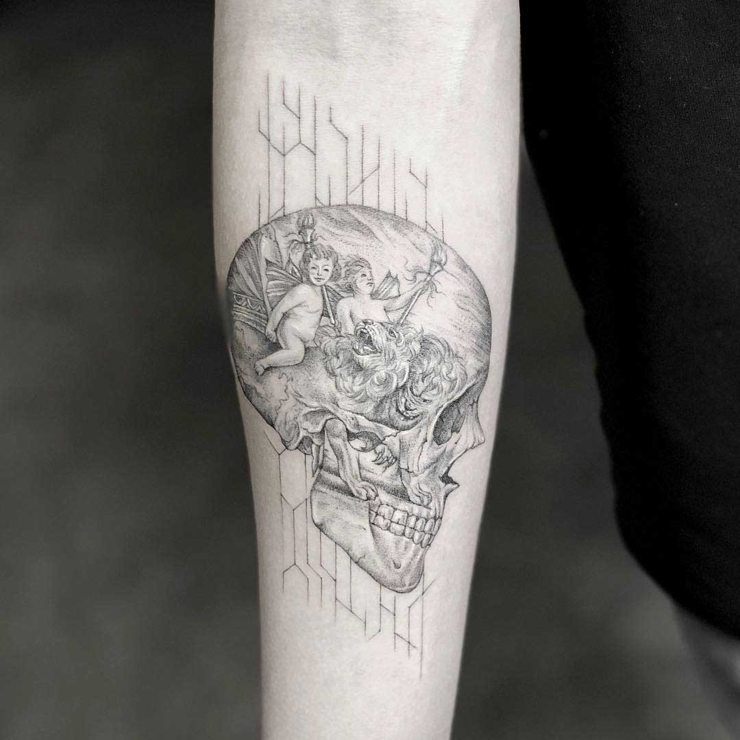 arm tattoo skull with angels inside