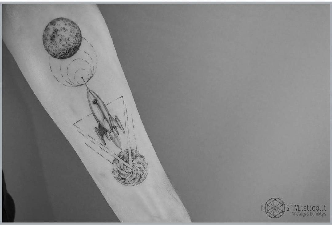 rocket tattoo wormhole and planet