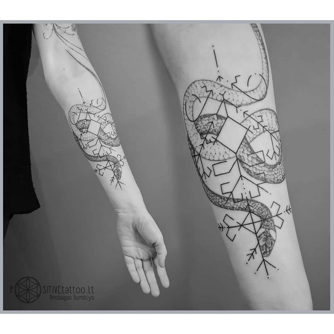 snake tattii with ethnic pattern