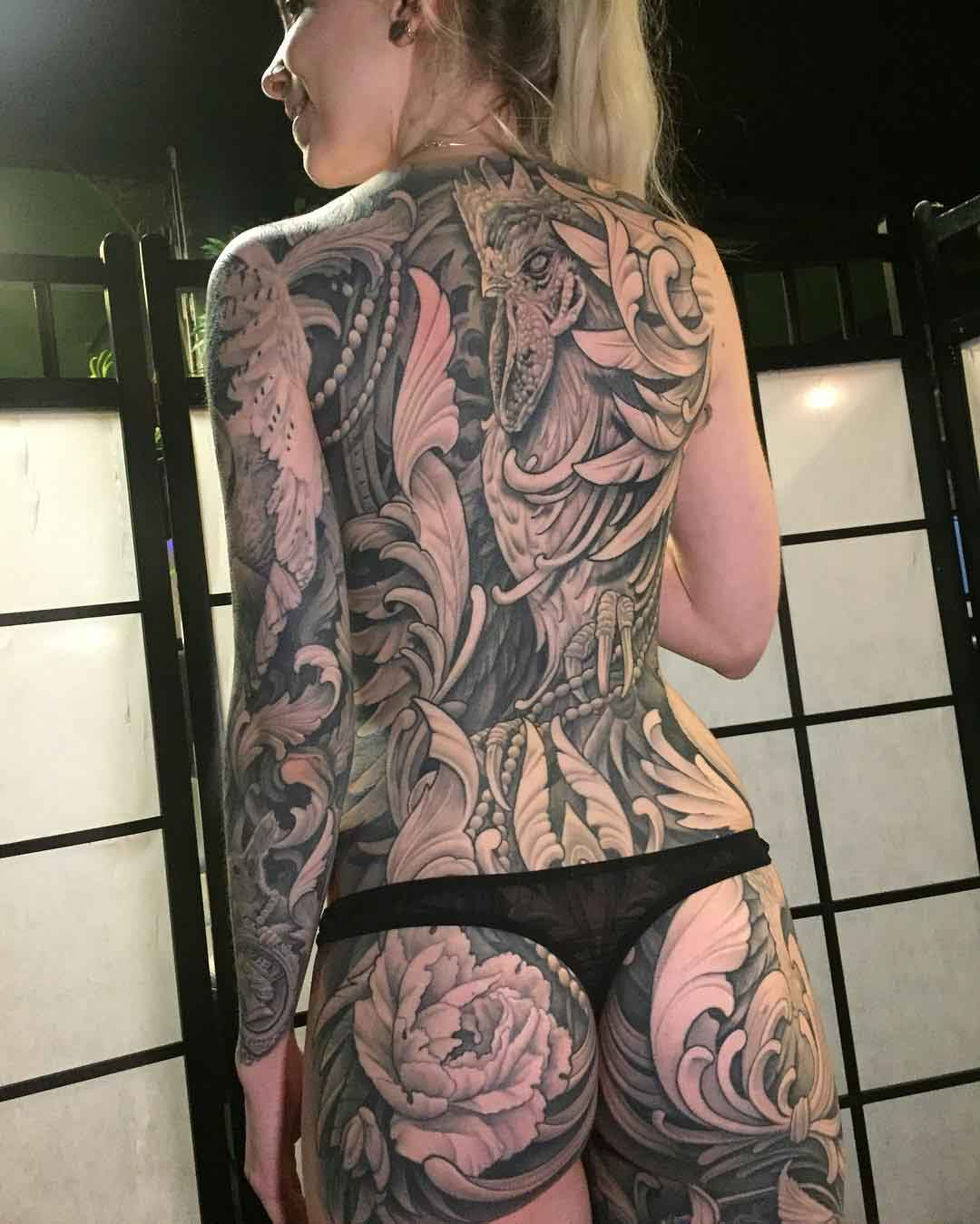 girl full back tattoo