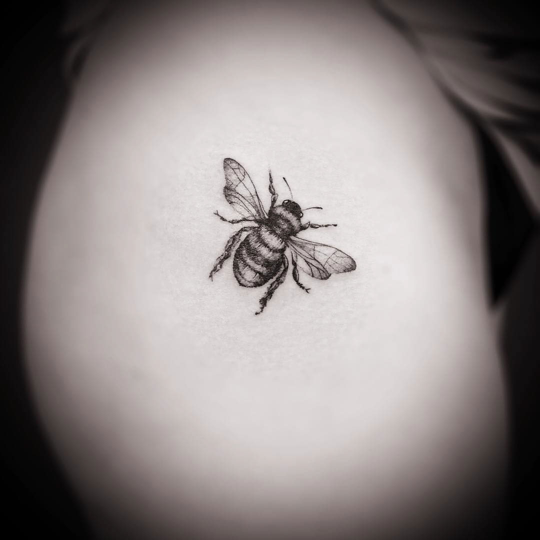 tiny tattoo of a bee