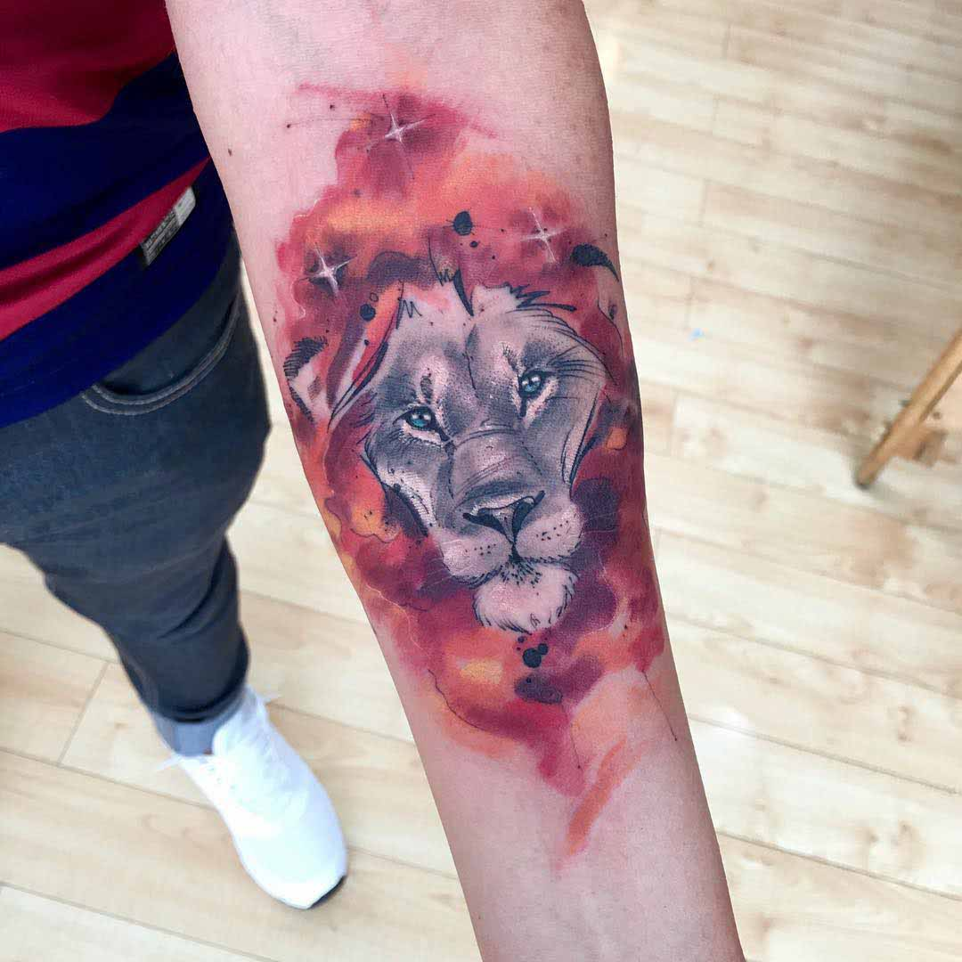 lion tattoo on arm watercolor style