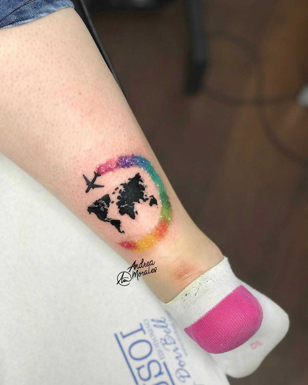 world trip tattoo on ankle