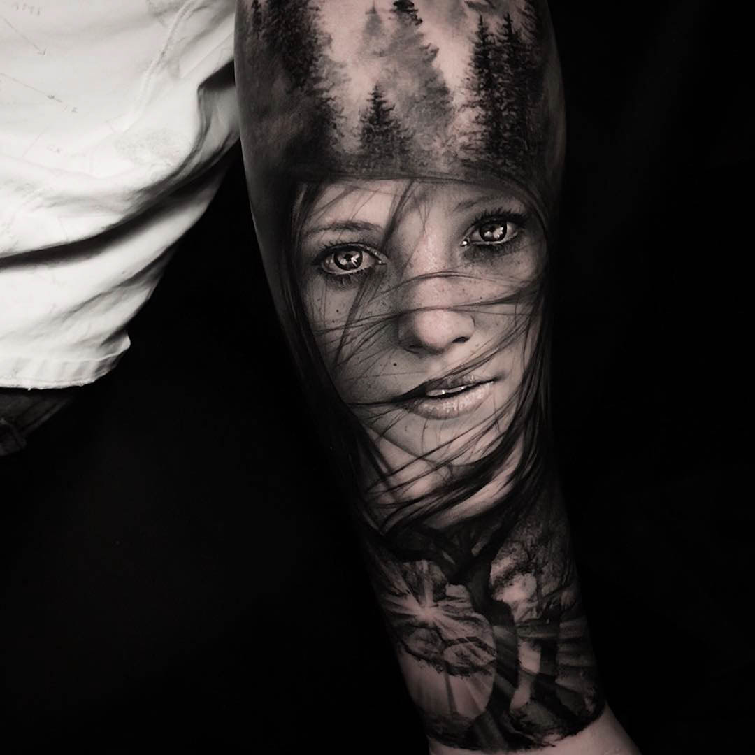 black and grey tattoo on arm