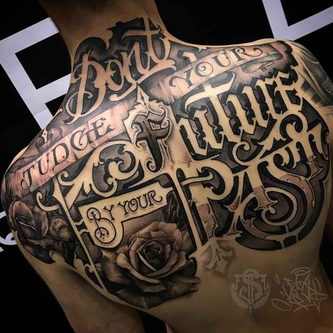 lettering tattoo on the upper back