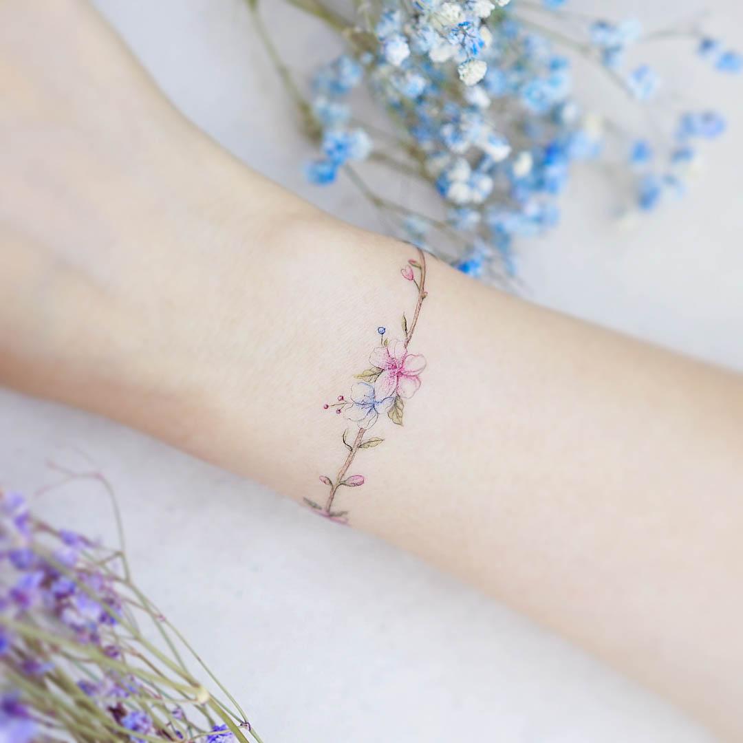 flower tattoo around the wrist