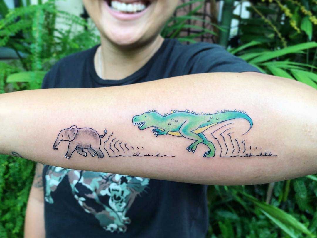 forearm tattoo dinosaur and elephant