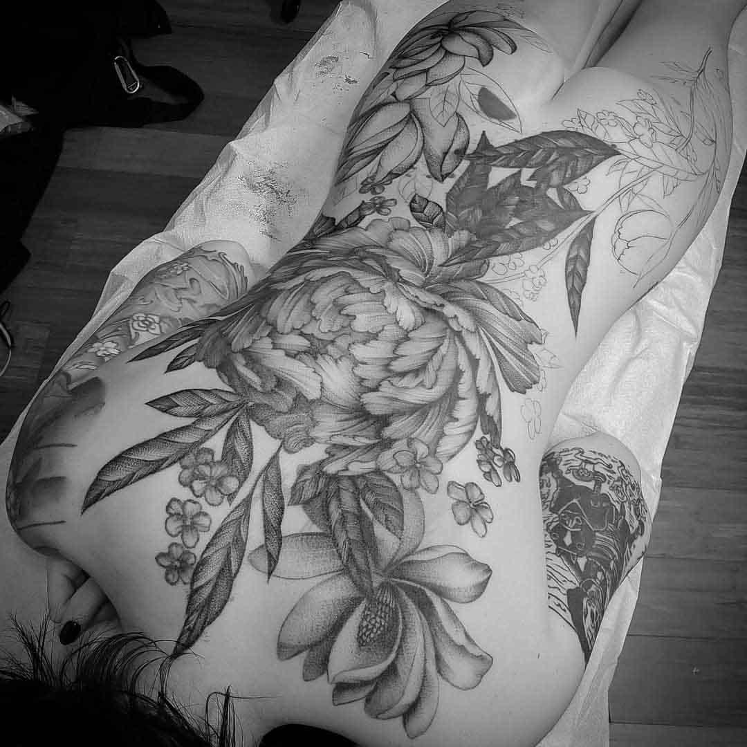 big flowers tattoo on back in progress