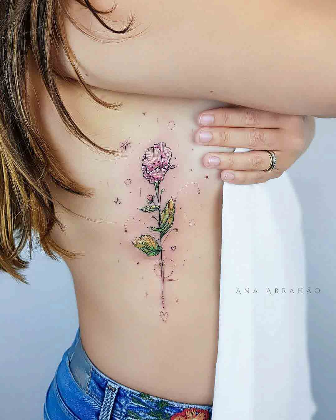 ribs tattoo flower