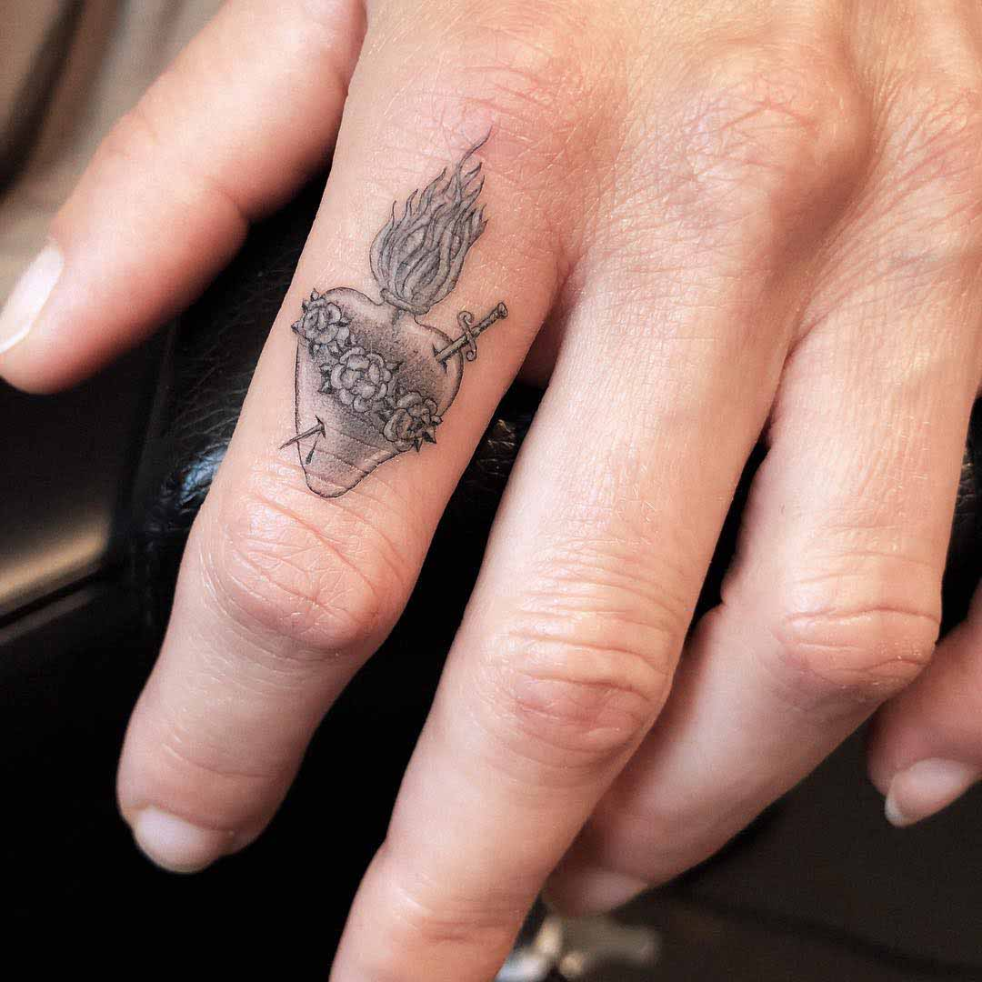 finger tattoo sacred heart