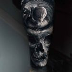 Fetus Inside Skull Tattoo