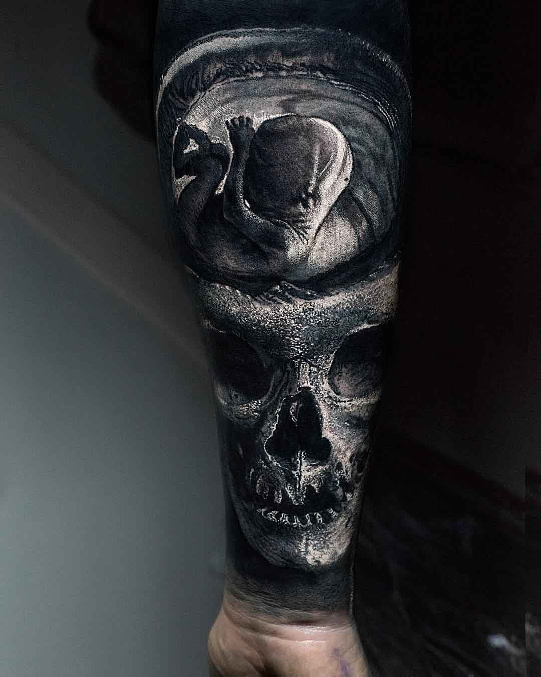 skull tattoo on arm fetus