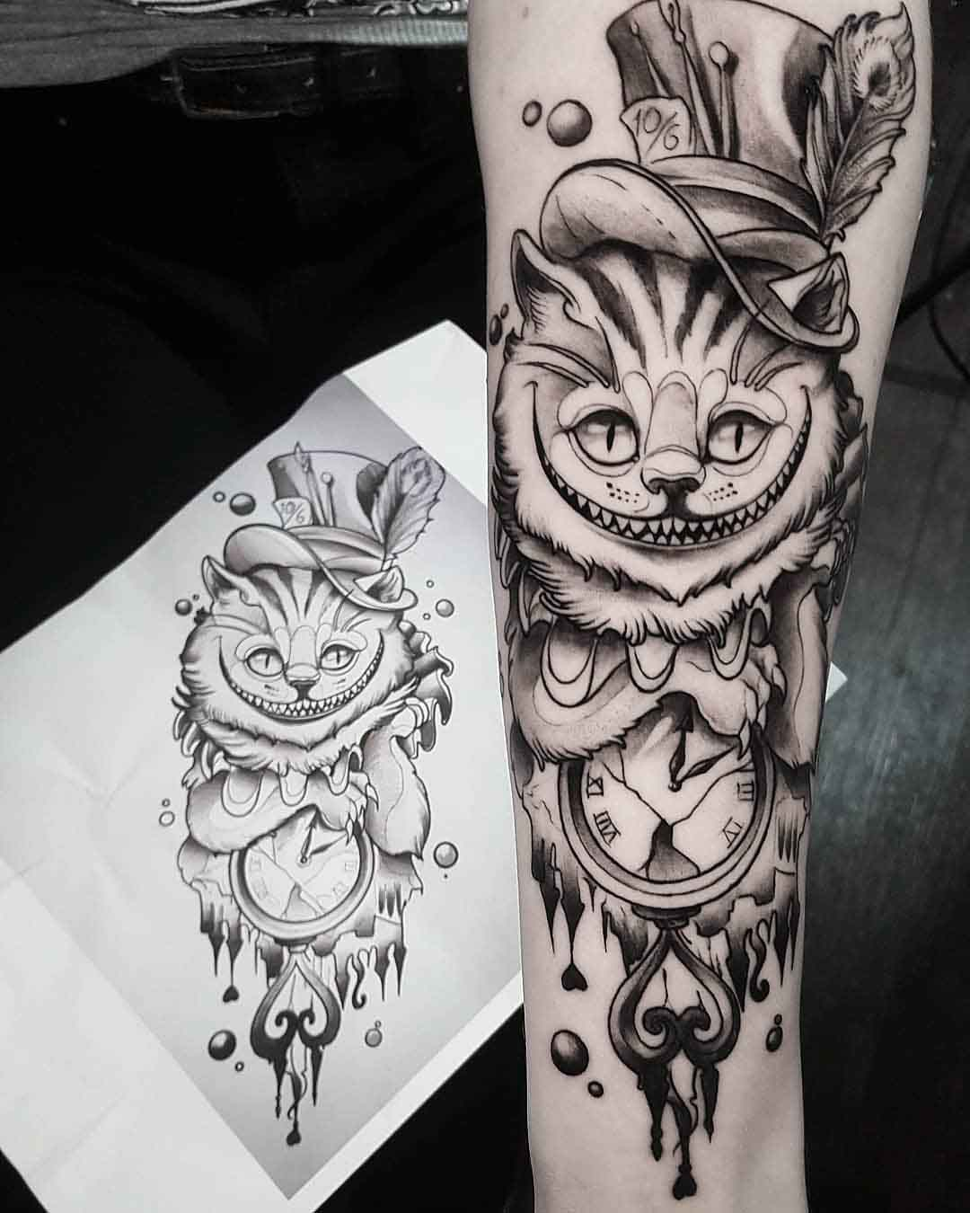 arm tattoo cheshire cat