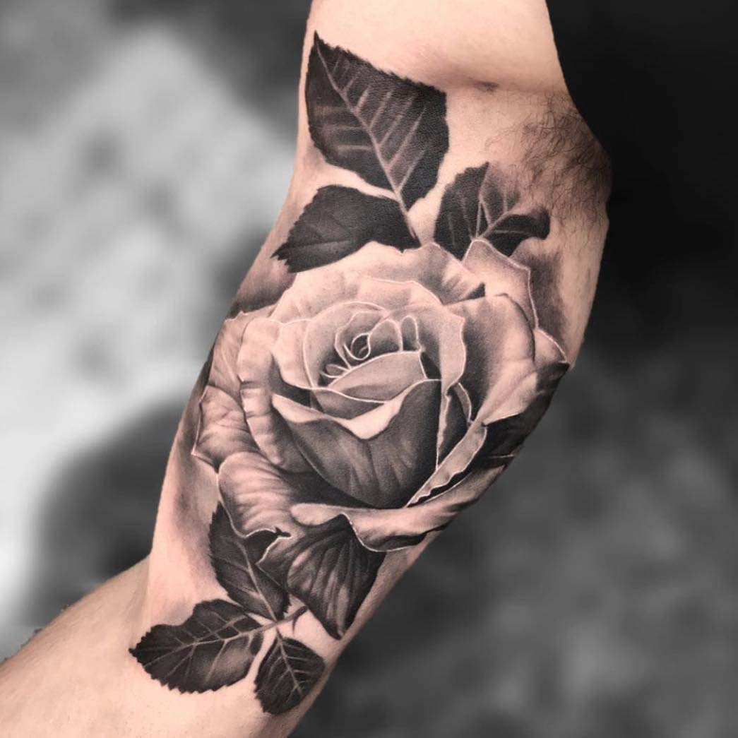 rose tattoo on innder bicep