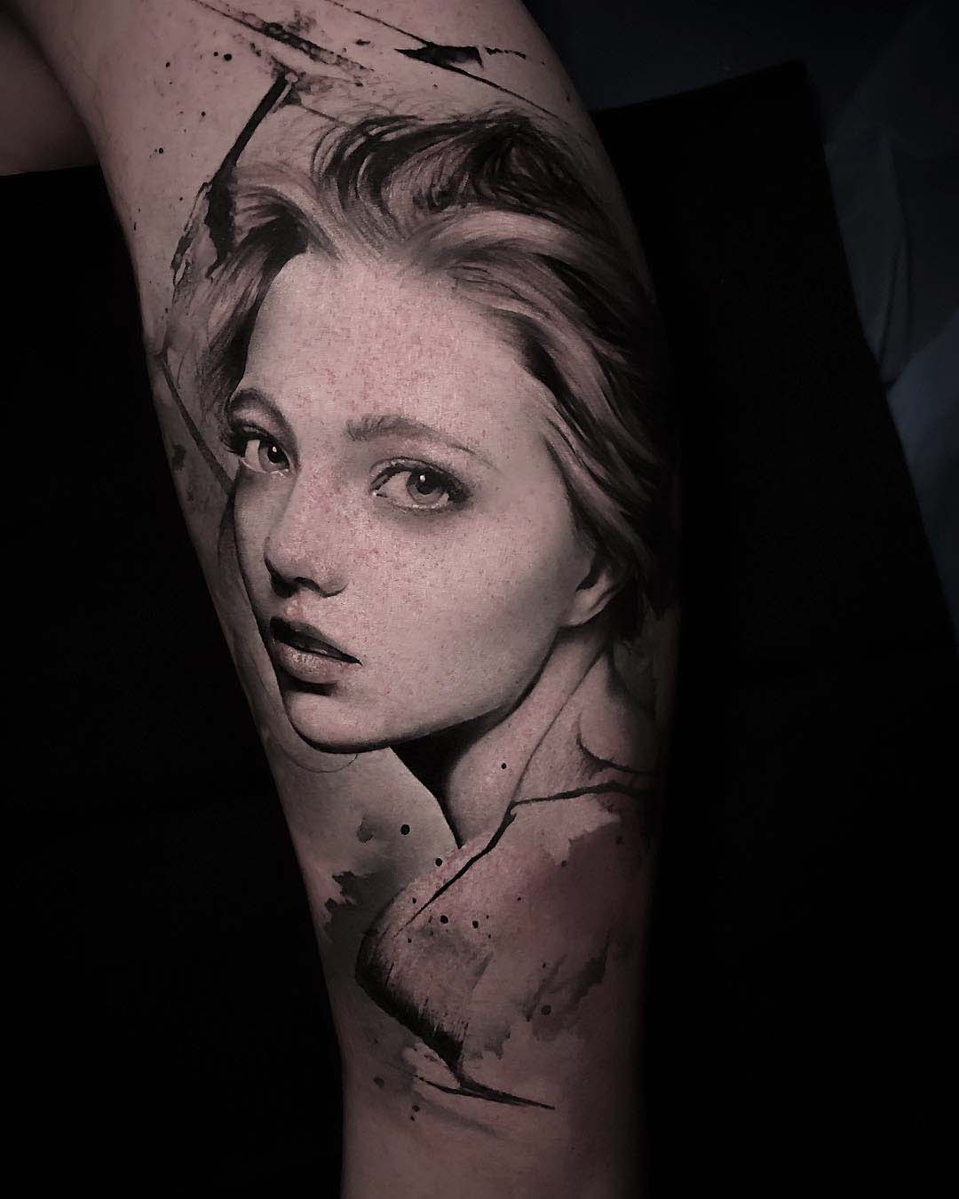 grey realistic portrait tattoo