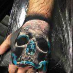 Blue Glow Skull Tattoo on Hand