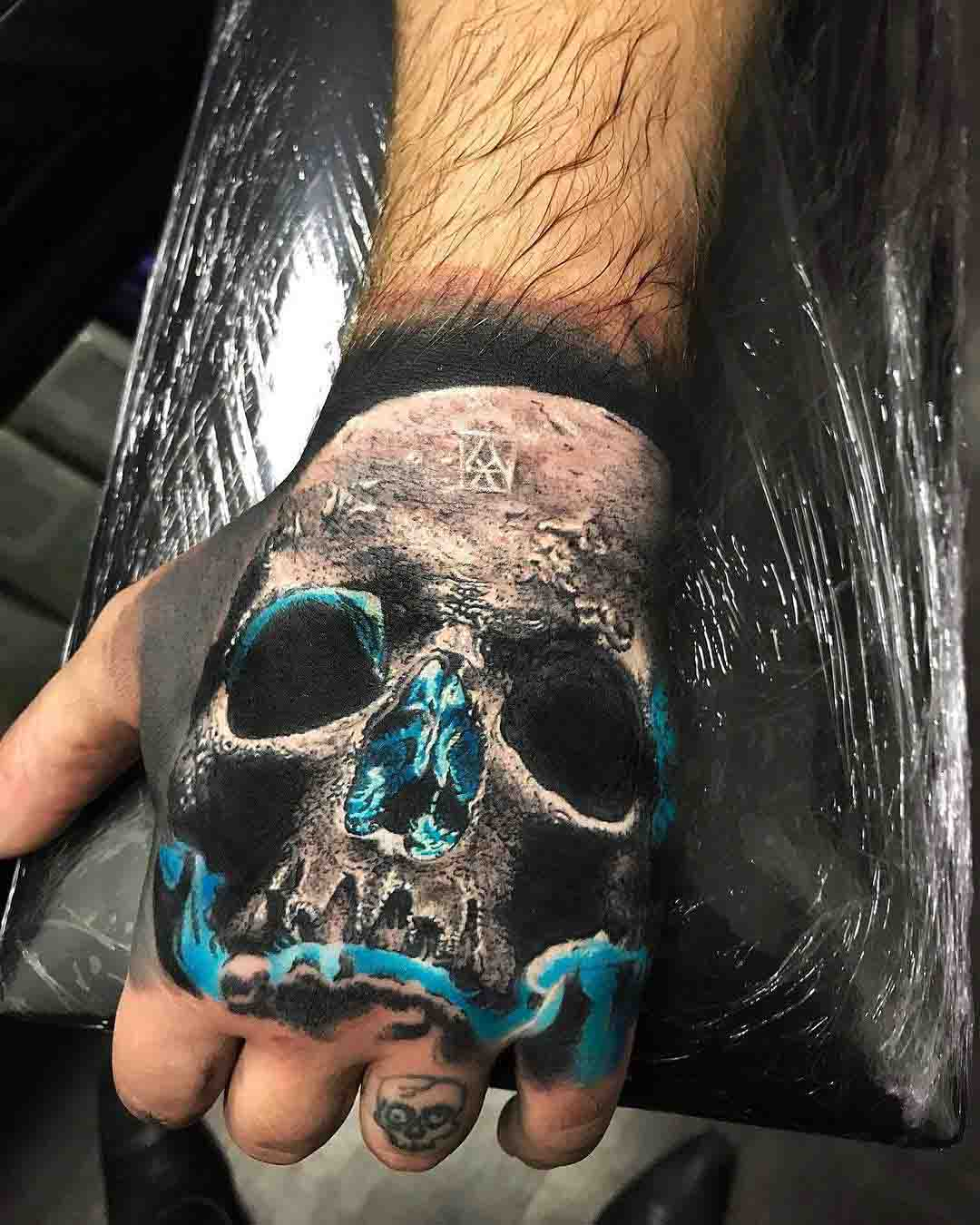 hand tattoo skull