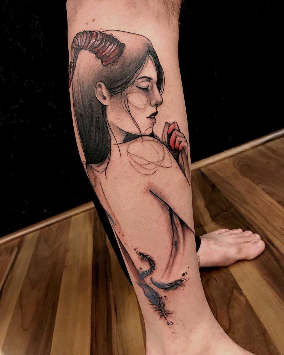 calf tattoo duality