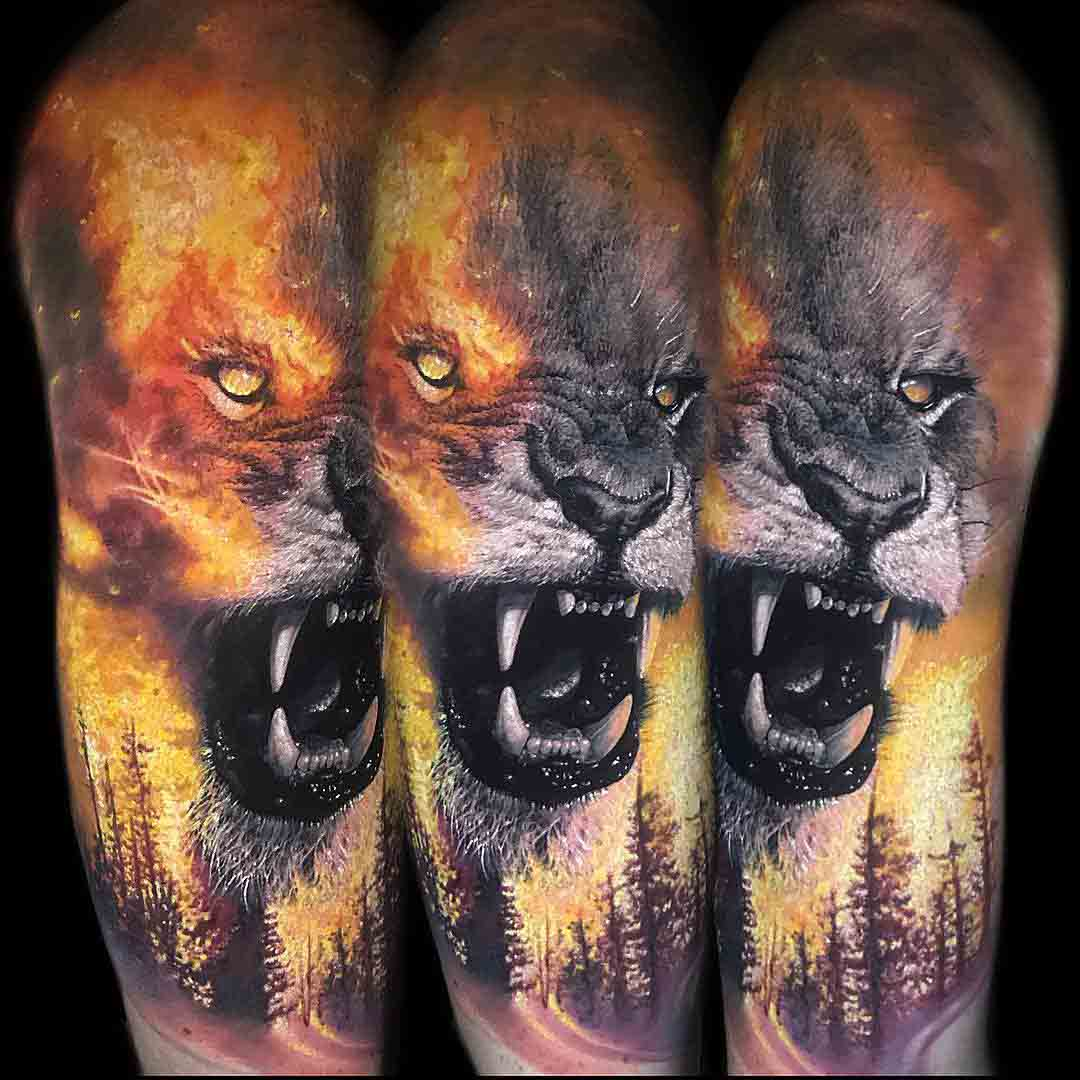 lion tattoo flames on shoulder