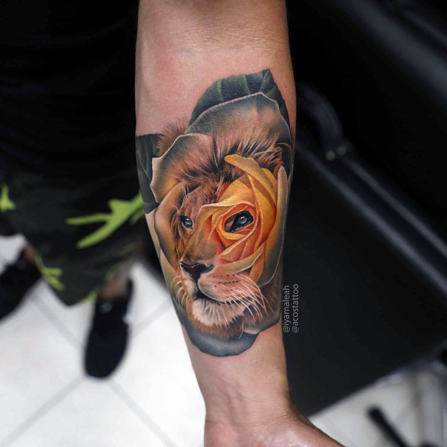 arm tattoo lion rose