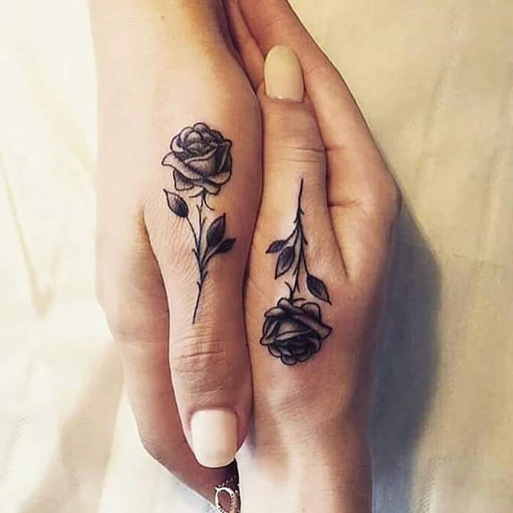 couple tattoo roses