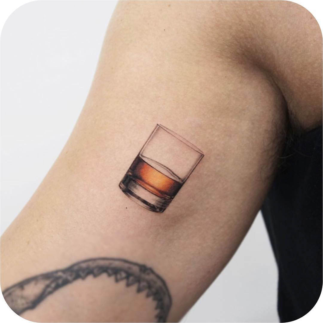 bicep tattoo whiskey