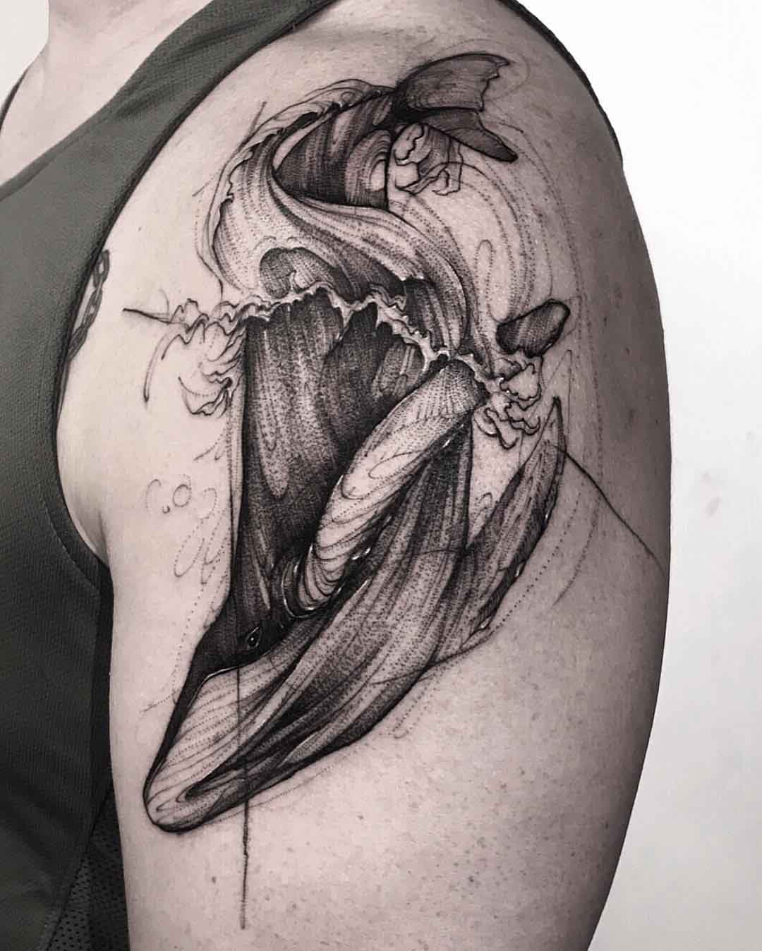 sketchy whale tattoo on shoulder